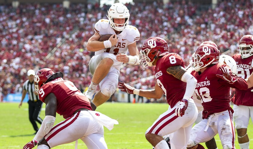 Texas quarterback Sam Ehlinger leaps into the end zone to score against Oklahoma on Oct. 6, 2018.