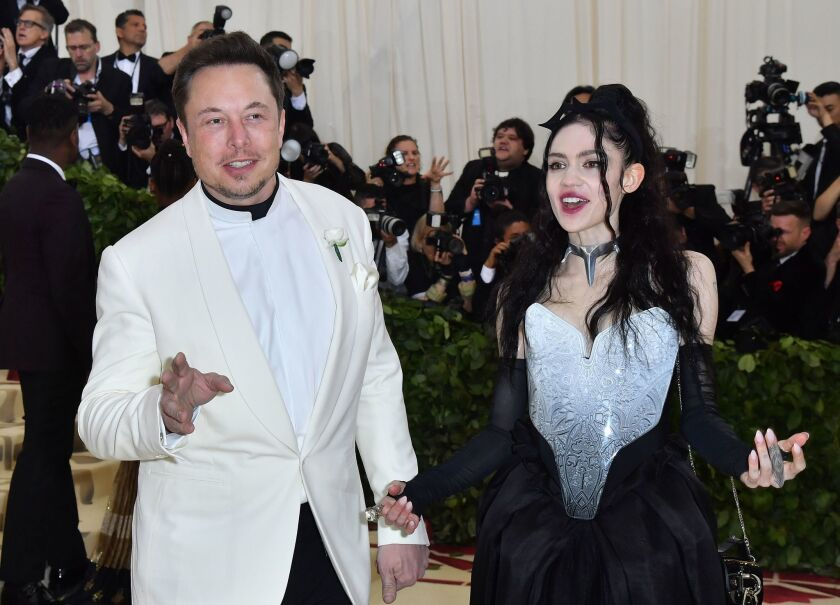 Musk and the musician Grimes in the old days, at a New York City gala in 2018, before the coronavirus hit. Grimes is now pregnant, and Musk tweeted Friday morning that she is mad at him.