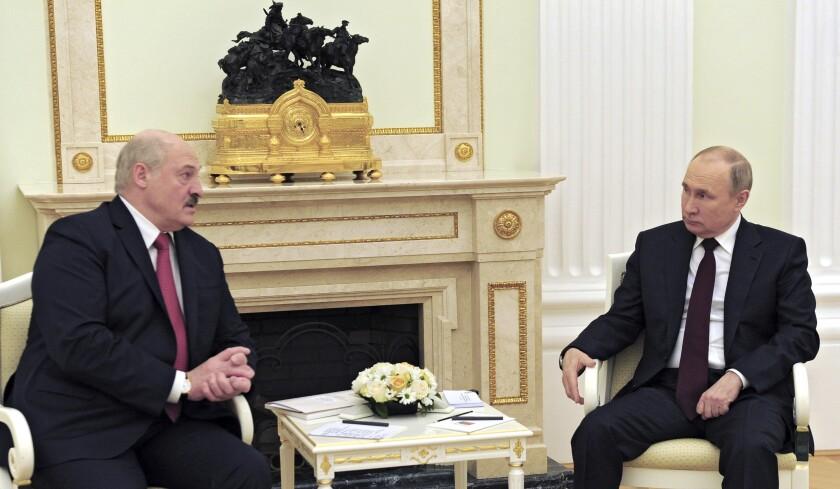 Russian President Vladimir Putin, right, and Belarusian President Alexander Lukashenko talk during their meeting in Moscow, Russia, Thursday, April 22, 2021. (Mikhail Klimentyev, Sputnik, Kremlin Pool Photo via AP)