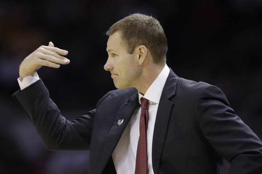 Iowa State coach Fred Hoiberg calls to his players during the first half of a third-round game against North Carolina in the NCAA college basketball tournament Sunday, March 23, 2014, in San Antonio. (AP Photo/David J. Phillip)