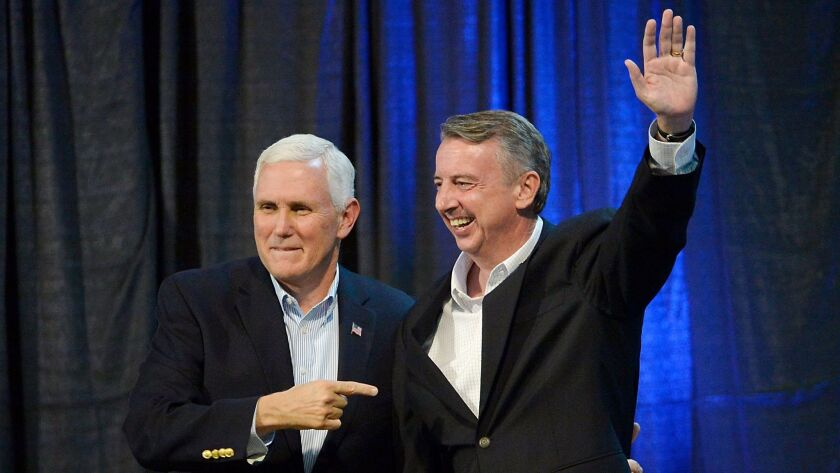 Vice President Mike Pence points to GOP gubernatorial candidate Ed Gillespie of Virginia during a campaign rally Saturday in Abingdon, Va.