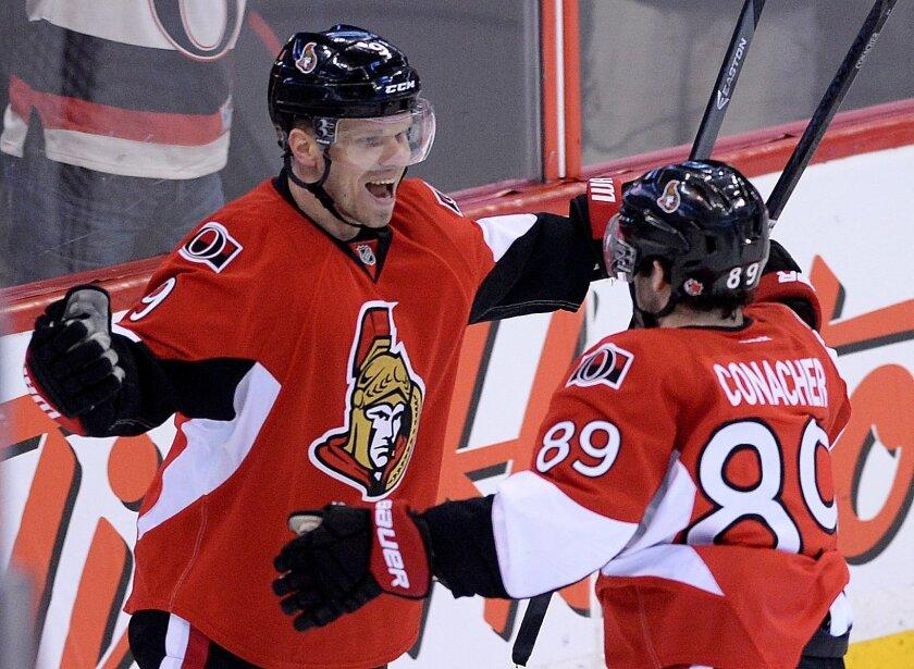 Ottawa Senators' Milan Michalek, left, celebrates a first-period goal with teammate Cory Conacher against the Winnipeg Jets during an NHL hockey game in Ottawa, Ontario, on Thursday, Jan. 2, 2014. (AP Photo/The Canadian Press, Sean Kilpatrick)