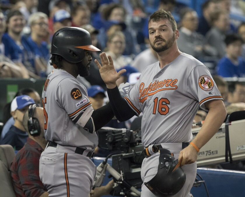 Baltimore Orioles Trey Mancini celebrates after scoring on a Renato Nunez double during the first inning of the team's baseball game against the Toronto Blue Jays on Tuesday, Sept. 24, 2019, in Toronto. (Fred Thornhill/The Canadian Press via AP)