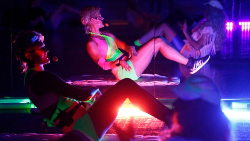 HyperBody's classes resemble a wild, sweaty, multimedia party, with light batons and music she composes herself.