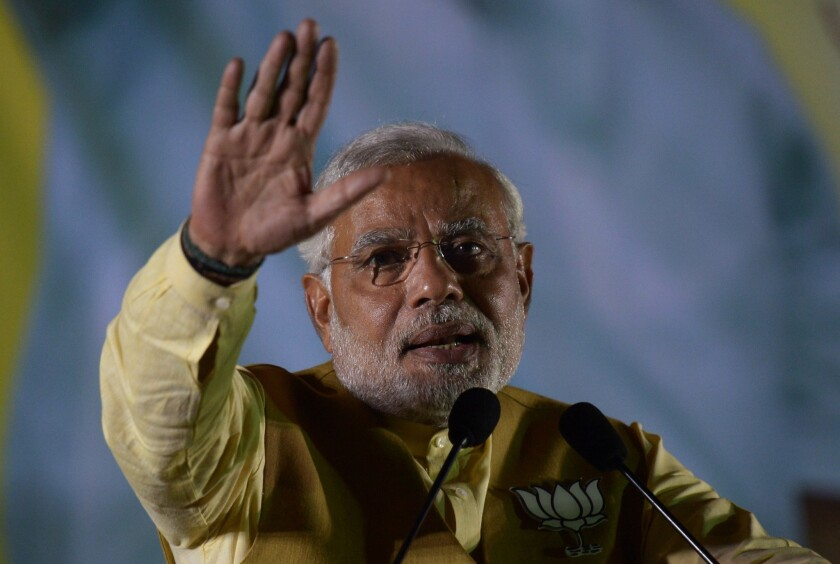 Narendra Modi, chief minister of India's western state of Gujarat and the main opposition Bharatiya Janata Party's candidate for prime minister, gestures as he speaks during a campaign rally in Kolkata.