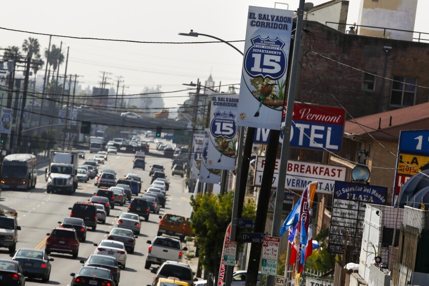 Signs denote the 12-block stretch of the El Salvador Corridor along Vermont Avenue near USC as the 15th Salvadoran state. It took a community leader about five years to win official approval of the area's name.