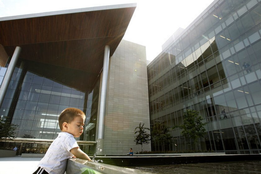 Issac Hernandez, 16 months, plays in a fountain at the new Gov. George Deukmejian Courthouse in Long Beach.