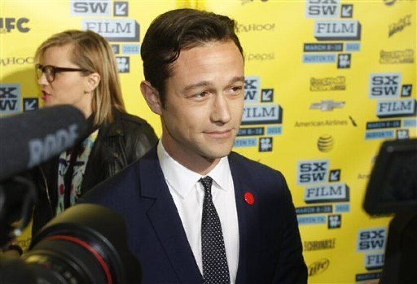 """Joseph Gordon-Levitt arrives at a screening of """"Don Jon's Addiction at the SXSW Film Festival, on Monday, March 11, 2013 in Austin, Texas. (Photo by Jack Plunkett/Invision/AP Images)"""