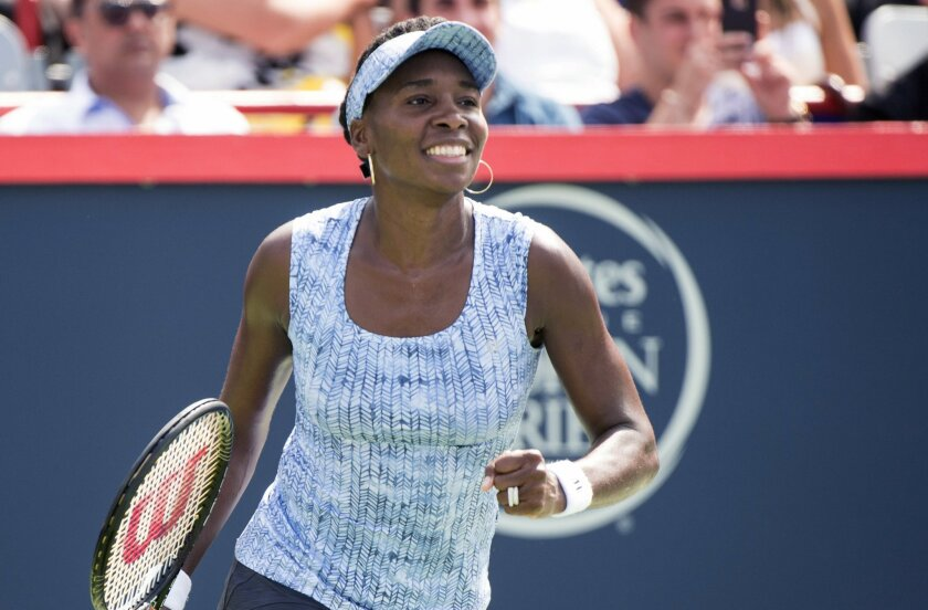 Venus Williams celebrates after defeating Anastasia Pavlyuchenkova, of Russia, in a first round match at the Rogers Cup tennis tournament in Montreal on Tuesday, Aug. 5, 2014. (AP Photo/The Canadian Press, Paul Chiasson)