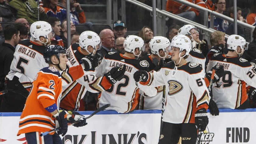 Anaheim Ducks' Rickard Rakell (67) celebrates a goal as Edmonton Oilers' Andrej Sekera (2) skates pa
