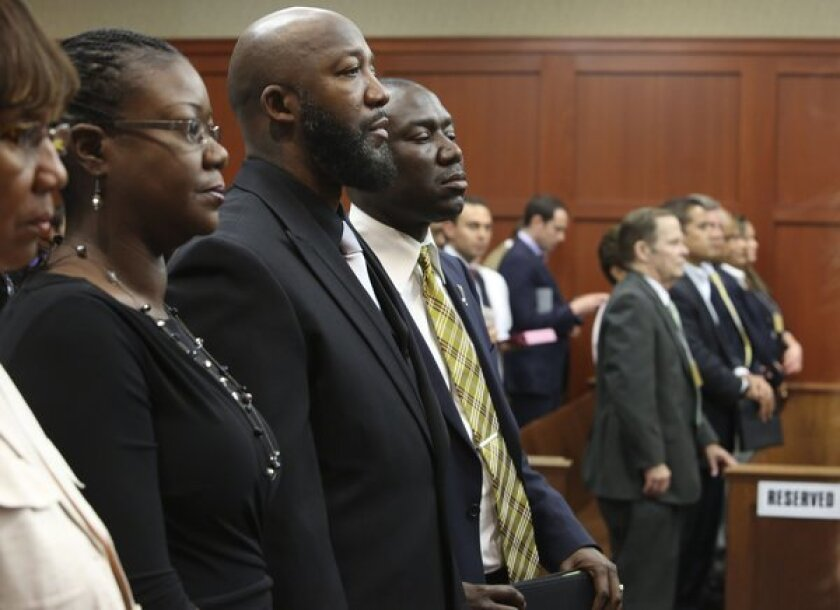 Trayvon Martin's parents, Sabrina Fulton and Tracy Martin, stand following closing arguments in the trial of George Zimmerman.