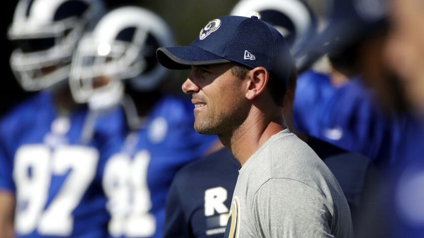 Rams offensive coordinator Matt LaFleur watches players practice at training camp ob July 29, 2017 in Irvine.