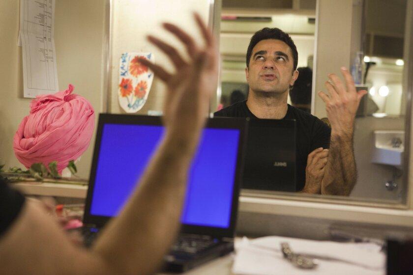 """Rafta Rafta"" actor Kamal Marayati warms up before being called to the stage. John R. McCutchen • U-T"