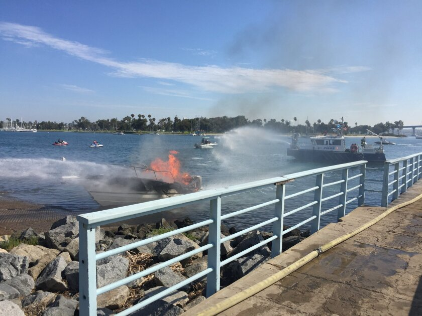 A San Diego Harbor Police boat assisted in dousing the flames at Glorietta Bay on Saturday.