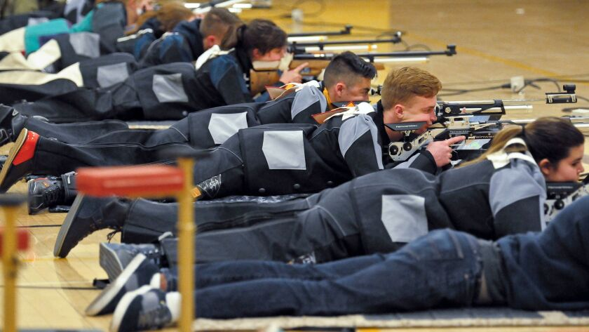 In this March 2, 2018 photo, a group of JROTC shooters compete in the prone position during the 2018