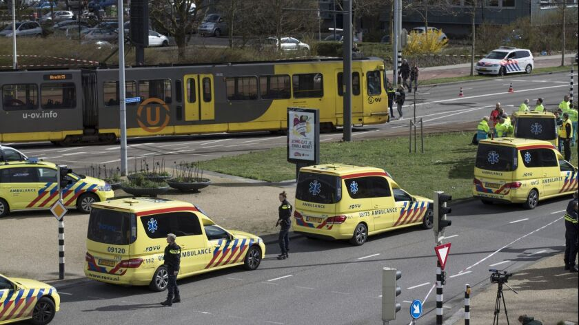 Ambulances are parked next to a tram after a shooting incident in Utrecht, Netherlands, Monday, Marc