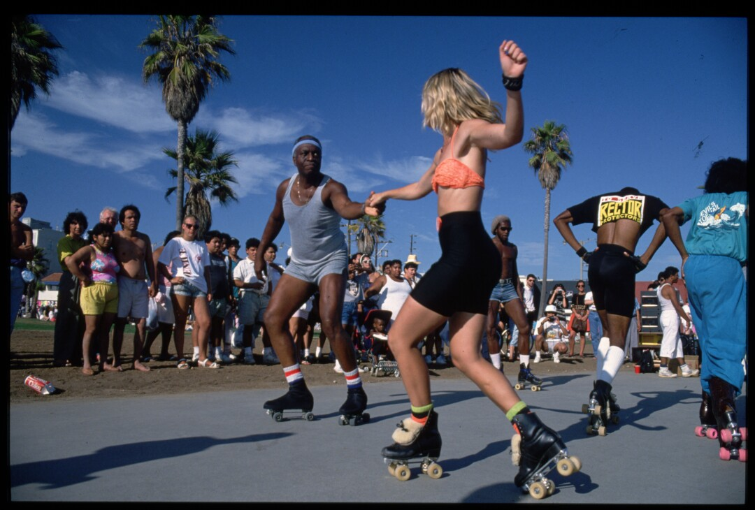 Roller skaters dance on the boardwalk at Venice Beach, Calif.