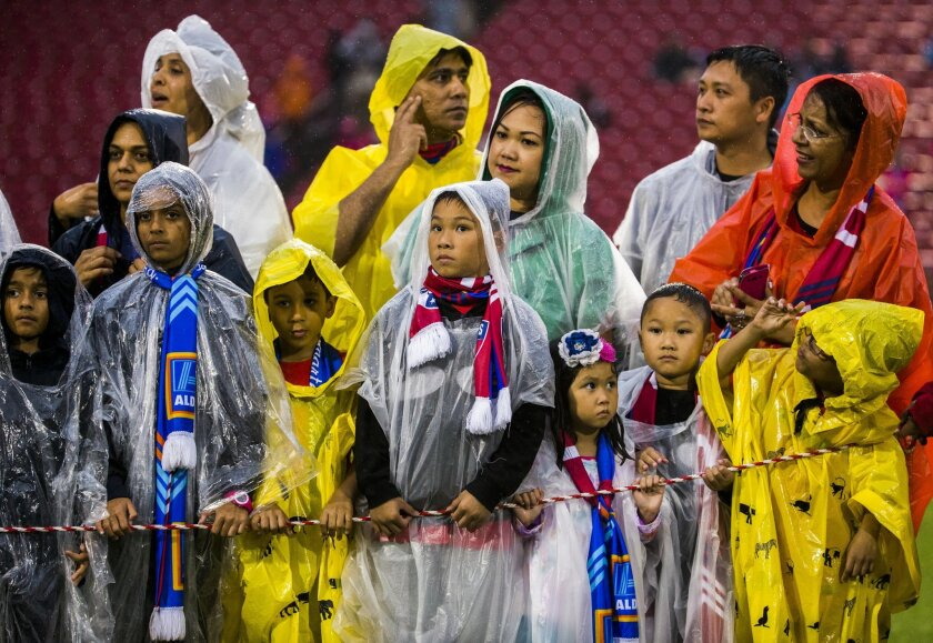 Children and their parents in rain panchos wait for team introductions before a MLS soccer game between FC Dallas and Houston Dynamo, Thursday, June 2, 2016, in Frisco, Texas.  (Ashley Landis/The Dallas Morning News via AP) MANDATORY CREDIT; MAGS OUT; TV OUT; INTERNET USE BY AP MEMBERS ONLY; NO SAL