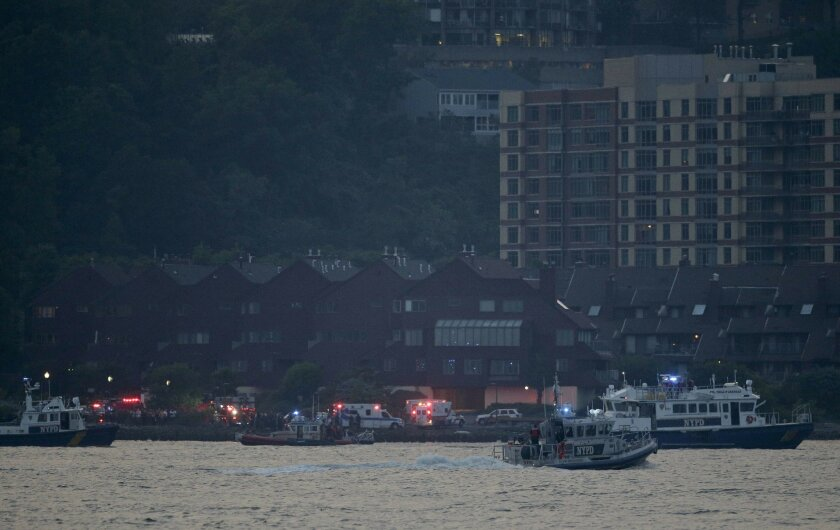 Search and rescue boats look for a small plane that went down in the Hudson River, Friday, May 27, 2016. The Federal Aviation Administration say it received a report a World War II vintage P-47 Thunderbolt aircraft may have gone down in the river 2 miles south of the George Washington Bridge. (AP P