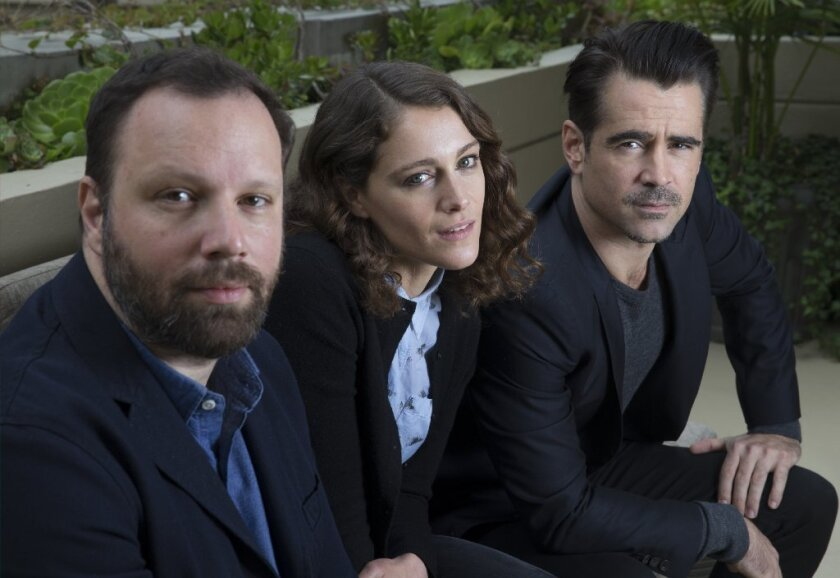 "Actors Colin Farrell, right, and Ariane Labed worked with filmmaker Yorgos Lanthimos, left, on ""The Lobster,"" a surreal romance in which single people must find a mate or be turned into an animal."