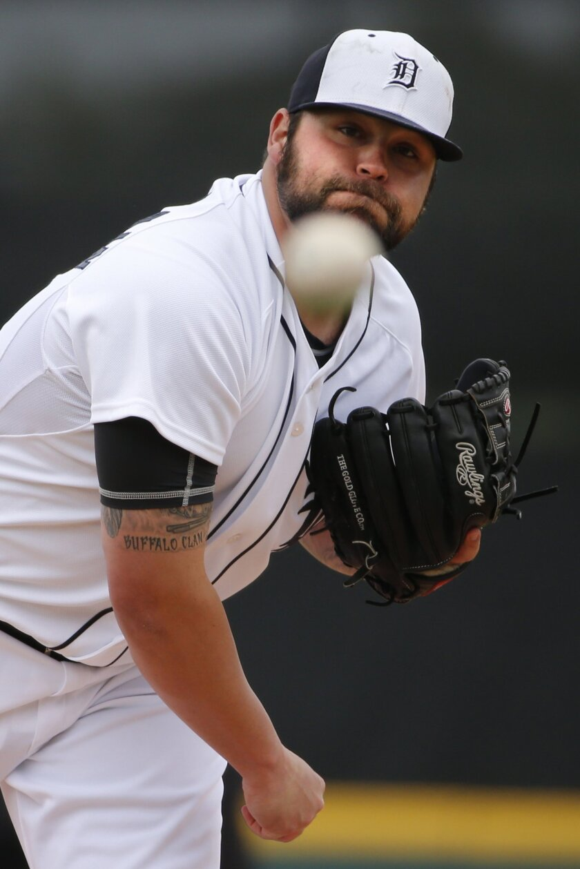Detroit Tigers relief pitcher Joba Chamberlain warms up before the fourth inning of an exhibition spring training baseball game against the Atlanta Braves in Lakeland, Fla.,  Thursday, Feb. 27, 2014. The Tigers won 5-2. (AP Photo/Gene J. Puskar)