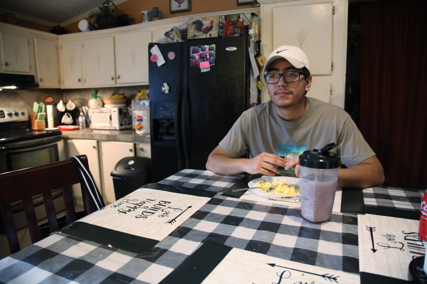 Samuel Alfaro, pauses between responses during an interview at his home in Houston, Texas