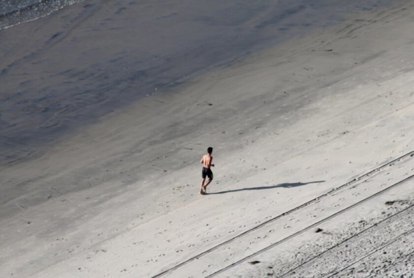 Fair weather makes for great jogging at Blacks Beach.