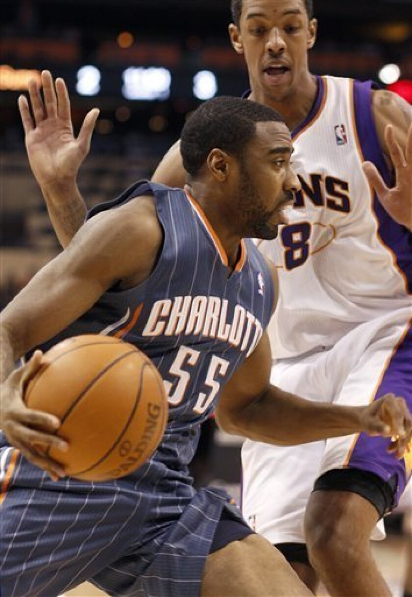 Charlotte Bobcats forward Reggie Williams, front, drives along the baseline past Phoenix Suns forward Channing Frye, rear, in the first quarter of an NBA basketball game on Saturday, Feb. 4, 2012, in Phoenix.(AP Photo/Paul Connors)