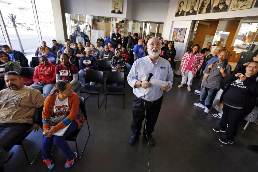 Father Gregory Boyle leads the morning meeting and prayer at Homeboy Industries.