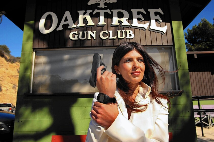 Belinda Padilla, chief executive of Armatix USA Inc., with the Armatix iP1 in 2013. The gun was displayed and demonstrated at the Oak Tree Gun Club in Newhall, Calif., but gun owners lashed out at the club.