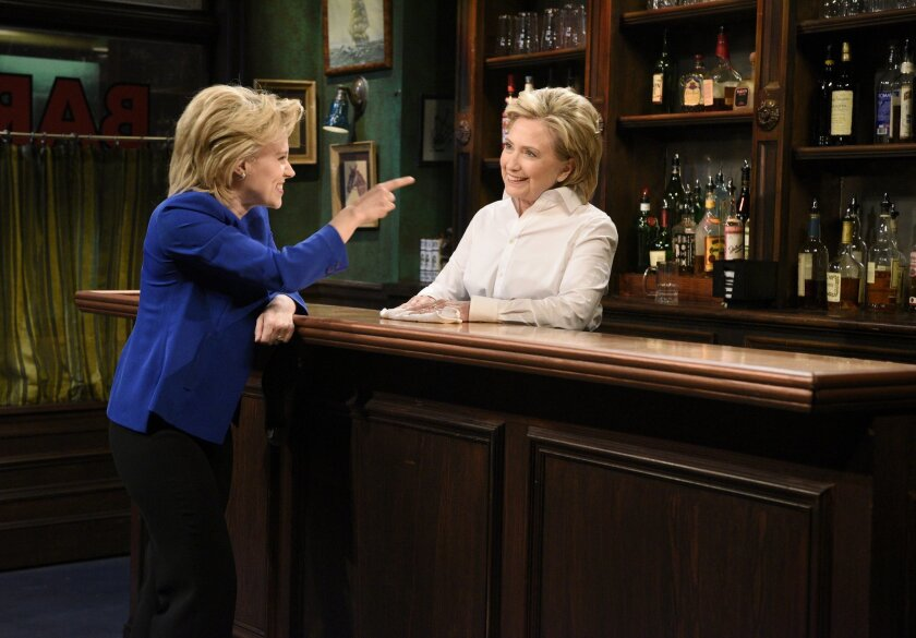 "In this Oct. 3, 2015 photo released by NBC, Kate McKinnon portrays Democratic presidential candidate Hillary Clinton, left, and Hillary Clinton portrays Val during the ""Bar Talk"" in a sketch from ""Saturday Night Live,"" in New York. Republican presidential candidate Donald Trump will host the popula"