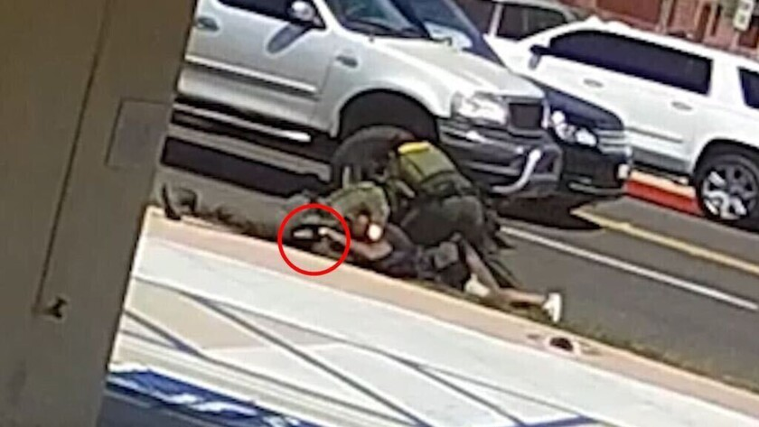 A still image from a security camera shows the struggle between two deputies and a homeless Black man shot dead.