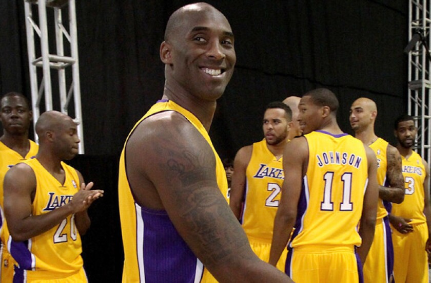 Kobe Bryant was all smiles at the Lakers' media day this fall. On Sunday, expect more of a scowl as he returns to the court for his season debut.