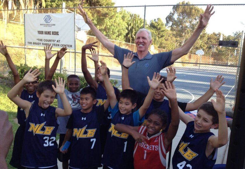 Bill Walton stands with youngsters at La Mesa Middle School during event July 24, 2014, announcing project for a new Boys & Girls Club on the middle school's campus.