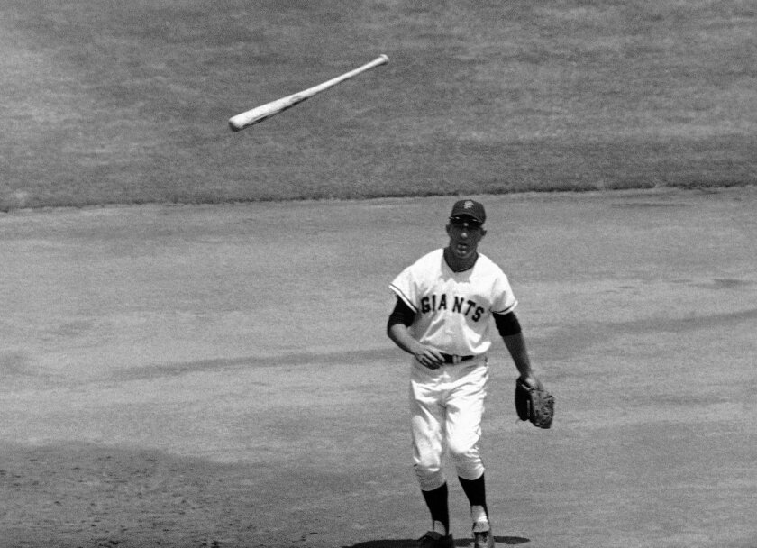 FILE - In this July 16, 1967, file photo, San Francisco Giants third baseman Jim Davenport looks at the bat thrown by Chicago Cubs' Adolfo Phillips in the second inning of  a baseball game in San Francisco. Jim Davenport, a longtime third baseman for the Giants who later managed the team and worked