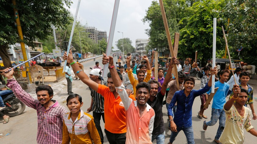 Members of India's low-caste Dalit community protest Wednesday the recent beating of four Dalit men who were attacked while trying to skin a dead cow last week in Gujarat state.
