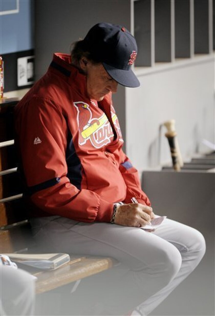 St. Louis Cardinals manager Tony La Russa makes a note during the seventh inning against the Los Angeles Dodgers at Game 1 of the National League division baseball series in Los Angeles, Wednesday, Oct. 7, 2009. (AP Photo/Mark J. Terrill)