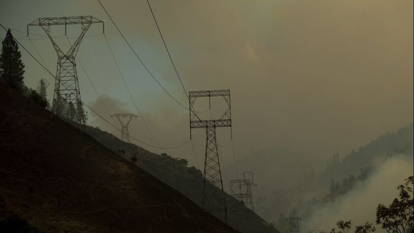 Power transmission lines crest a hilltop above Camp Creek Road, the point of origin of the Camp fire