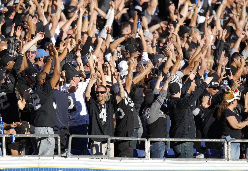 Oakland Raiders fans celebrate a touchdown against the Chargers at Qualcomm Stadium on Dec. 18, 2016.