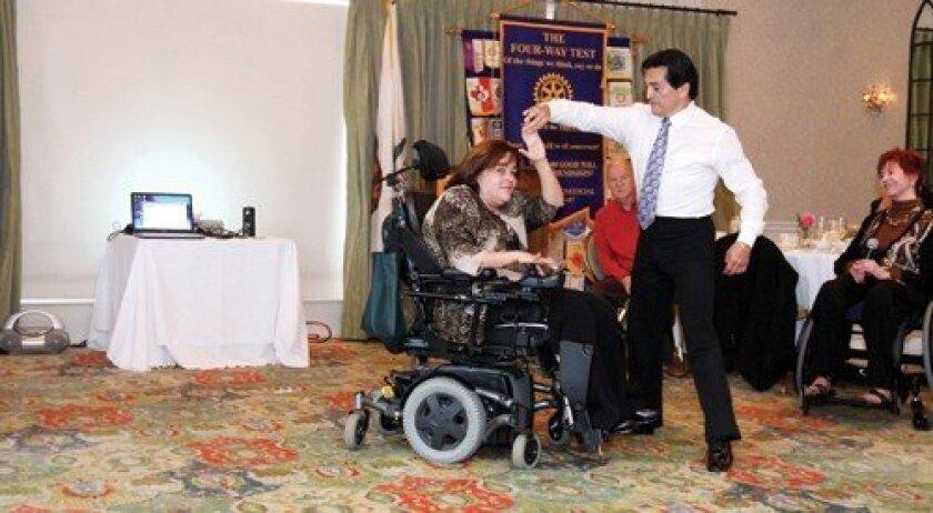 William Valencia gives a wheelchair dance demonstration with Wanda Chenier. Photo: Jon Clark