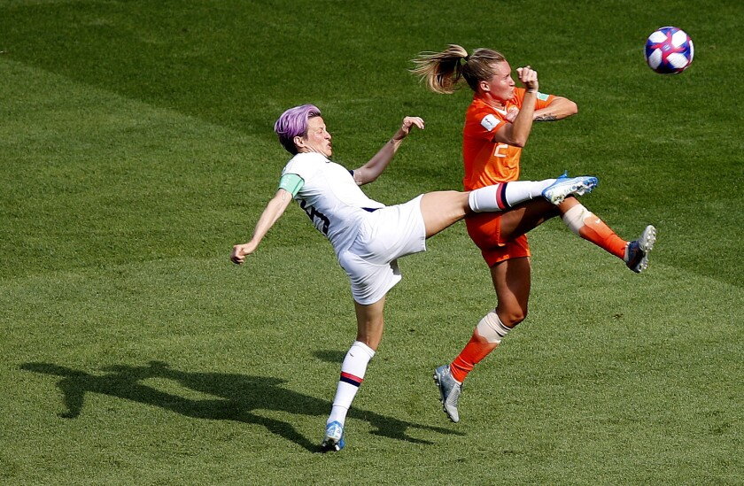 United States' Megan Rapinoe , left, and Netherlands' Desiree Van Lunteren challenge for the ball du