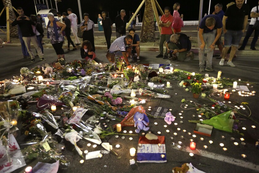 In Nice, flowers and candles honor the victims of a truck attack in Nice that left 84 dead.