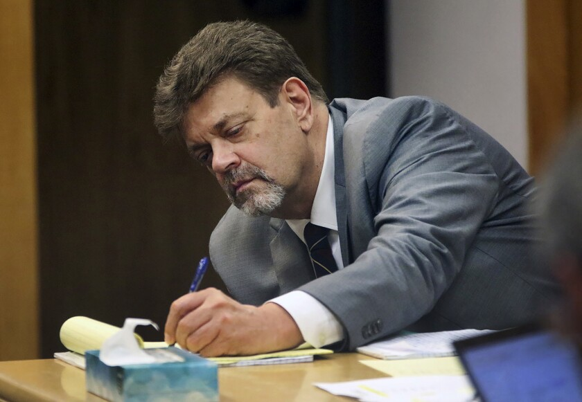FILE - In this June 29, 2021, file photo, Mark Redwine takes notes as a former sheriff's investigator, testifies during his trial in Durango, Colo. Redwine was sentenced, Friday, Oct. 8, 2021 to 47 years in prison for the 2012 disappearance of his 13-year-old son. The Durango Herald reports that Redwine, 60, was convicted of second-degree murder and child abuse resulting in the death of his son Dylan Redwine. (Jerry McBride/The Durango Herald via AP, File)