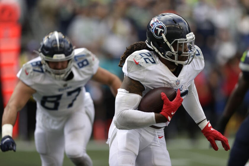 Tennessee Titans running back Derrick Henry (22) rushes against the Seattle Seahawks during the second half of an NFL football game, Sunday, Sept. 19, 2021, in Seattle. The Titans won 33-30 in overtime. (AP Photo/John Froschauer)