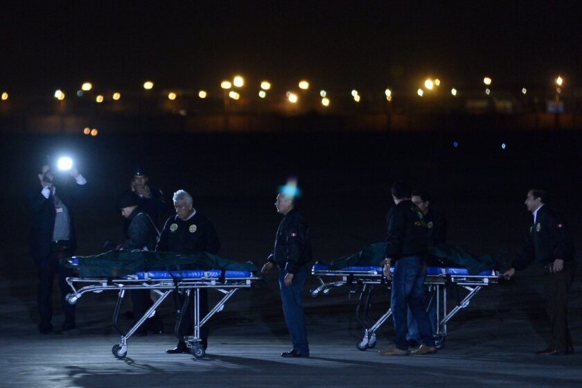 The bodies of two leaders of the guerrilla group Shining Path are brought into an air force base in El Callao, Peru.