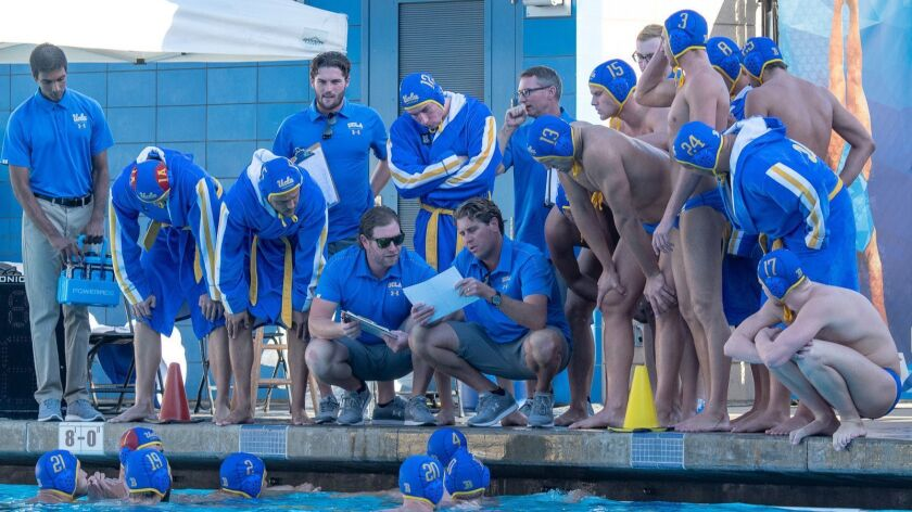 UCLA Water polo coach Adam Wright, center, right, coaching his team during a game againt Stanford o