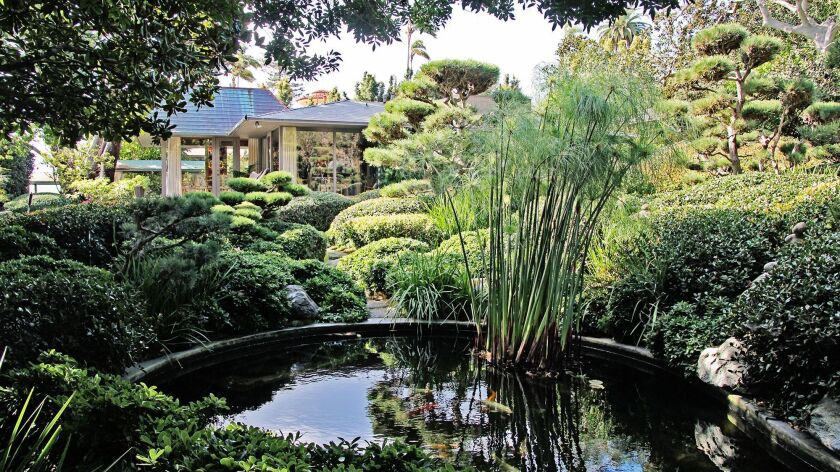An Asian-style garden with sculpted trees and a Koi pond is one of eight gardens in the Wooded Area
