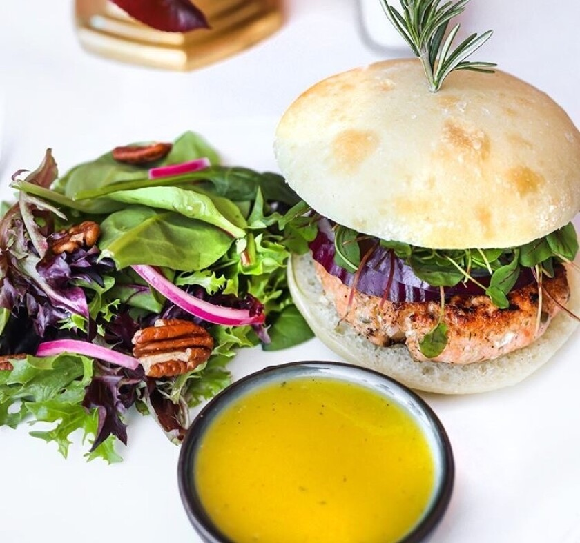 Grilled salmon burger on a potato bun is one of the meals featured on Pure Meal Prep San Diego's menu.