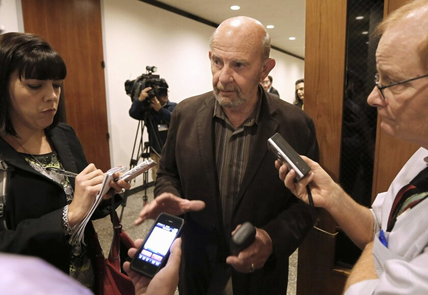 FILE - In this Nov. 8, 2013 file photo, John Tos, a Hanford farmer and the lead plaintiff in a lawsuit to block the sale of bonds to build California's bullet train, talks with reporters after a hearing in the case in Sacramento County Superior Court in Sacramento, Calif. Kings County Counsel Colle