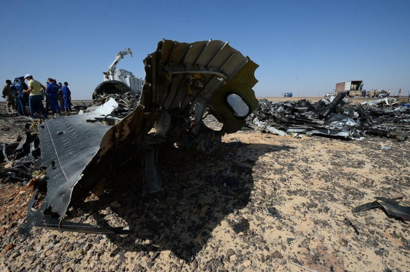 In this Russian Emergency Situations Ministry photo, made available on Monday, Nov. 2, 2015, Russian Emergency Ministry experts work at the crash site of a Russian passenger plane bound for St. Petersburg in Russia that crashed in Hassana, Egypt's Sinai Peninsula, on Monday, Nov. 2, 2015. A Russian